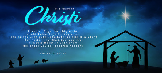 Christmas time. Manger with baby Jesus, Mary, Joseph and star of Bethlehem. Text: The Birth of Christ and Luke 2:10-11 (in German)