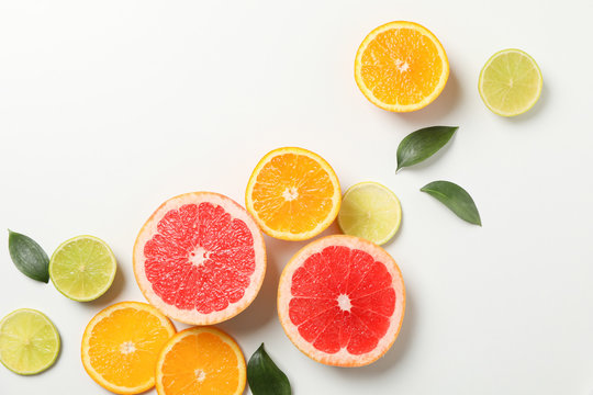 Flat lay with exotic fruits on white background, top view