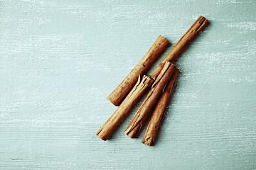 Ceylon cinnamon sticks on wooden background. Natural spices