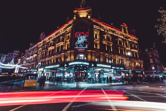 LONDON - NOVEMBER 13, 2019: People and traffic at night by Hippodrome Casino in Leicester Square London