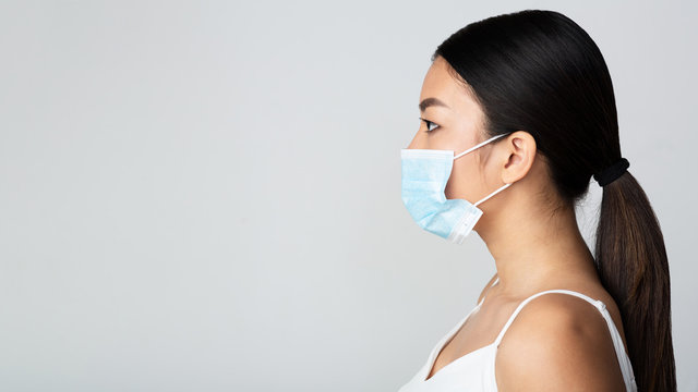 Infection concept. Asian girl wearing medical mask