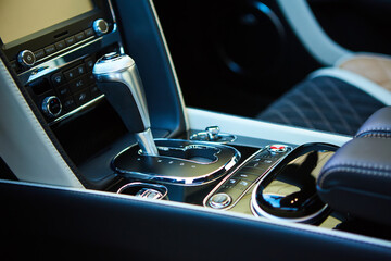 Detail of modern car interior, gear stick.