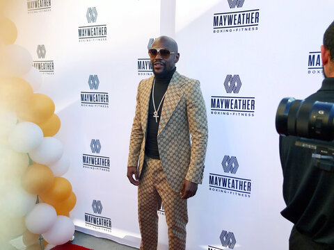 Floyd Mayweather poses for photos on the red carpet at the opening of the Mayweather Boxing + Fitness gym in Torrance