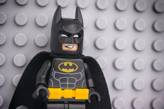 Tambov, Russian Federation - November 08, 2019 Portrait of Lego Batman minifigure standing against Lego gray baseplate background.
