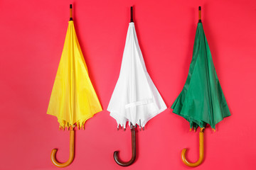 Wall Mural - Colorful umbrellas on red background, flat lay