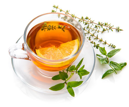 Herbal tea with mint thyme and lemon. Top view. Isolated on white background.