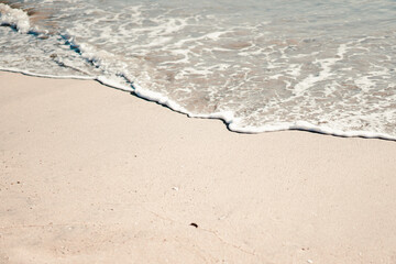On the picture is Pacific Ocean Long Beach shore. Azure blue sea water disappears in the sand.