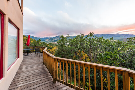 Aspen, Colorado house with wooden deck railing on balcony terrace and autumn foliage in roaring fork valley in 2019