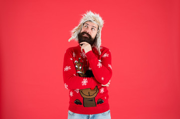 Make christmas wish. Life changing decision. Hipster bearded man wear winter sweater and hat. Happy new year. Winter party outfit. Man thoughtful face expression. Hard decision. Decision making