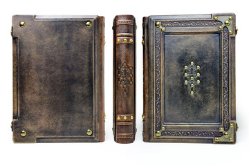 Large medieval book cover with the tree of life, leather bound with brass corners over the white background in high resolution