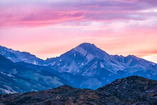 Aspen, Colorado rocky mountains view and colorful purple pink blue sunset twilight with Snowmass mountain peak ridge closeup