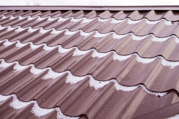 Installation of a metal roof in winter time.