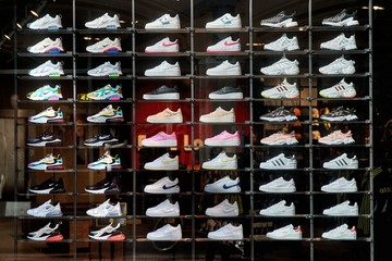 AMSTERDAM, THE NETHERLANDS - SEPTEMBER 15, 2019: Showcaseing a collection fashionable new shoes in a shop window of a retail store in a fancy shopping street in Amsterdam