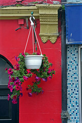 Bright colors and floral decoration on storefront in Boyle, Ireland