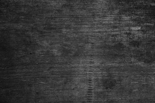 Image of a wooden table in front of an abstract background.