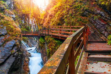Beautiful Wimbachklamm gorge with wooden path in autumn colors, Ramsau bei Berchtesgaden Fototapete
