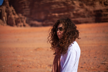 A woman's portrait by profile in a desert