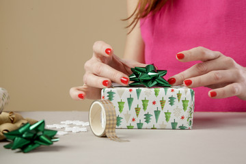 Woman wrapping Christmas presents, winter hoildays, gifting season concept