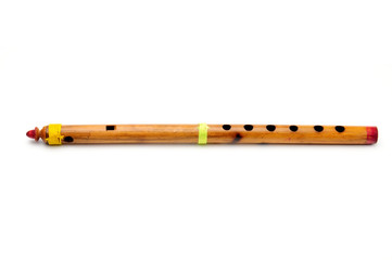 Bamboo wind instrument indian flute on white background