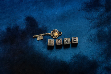 Ornamental keys around the Love wording with metal letters