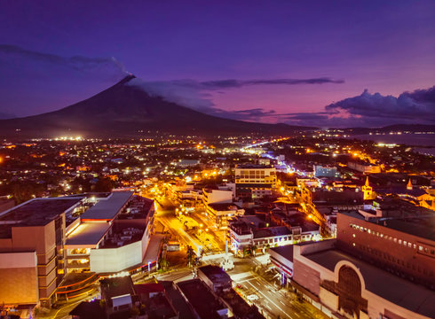 Mayon Volcano with Legazpi City lights in Legaspi City Albay Philippines