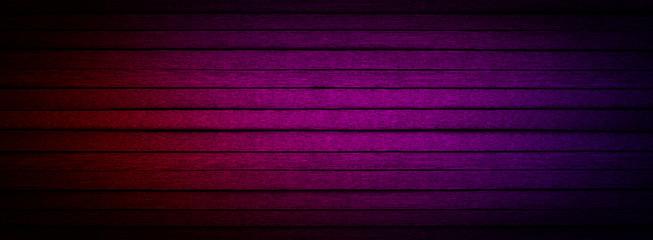 Dark wall with neon light on dark background