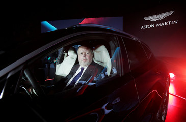 CEO of Aston Martin Andy Palmer poses for a photo inside the company's first sport utility vehicle Aston Martin DBX in Beijing