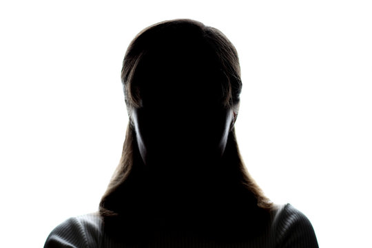 Dark silhouette of a young girl on white background, front view, concept of anonymity
