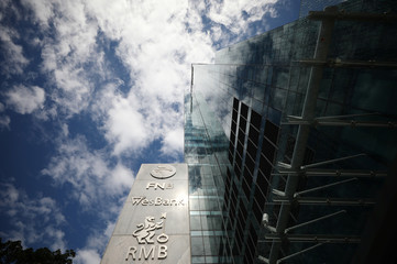 The logos of companies Rand Merchant Bank, FNB, and Wesbank are seen outside the FirstRand offices in Cape Town