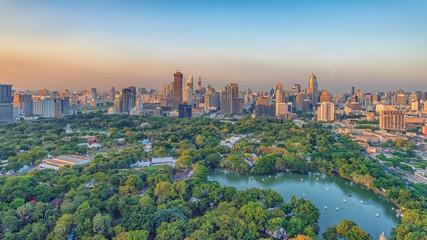 Fototapete - Lumphini Park and skyscrapers in Bangkok city, Thailand
