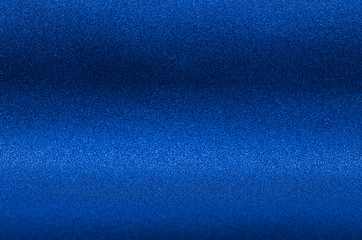 Ultramarine blue metallic glitter background for elegance rich luxury holiday design.