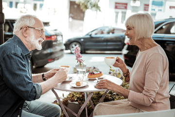 Positive elderly people enjoying their coffee together