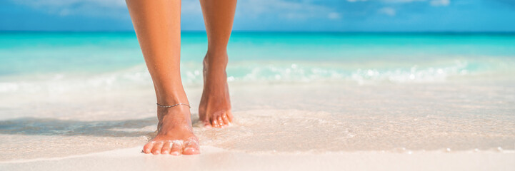 Photo sur Plexiglas Pedicure Woman feet walking on caribbean beach barefoot closeup of foot coming out of water after swim banner panorama. Honeymoon travel vacation,