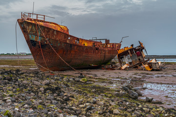 Garden Poster Shipwreck A rusty shipwreck in the mud of the Walney Channel, seen from the road to Roa Island, Cumbria, England, UK