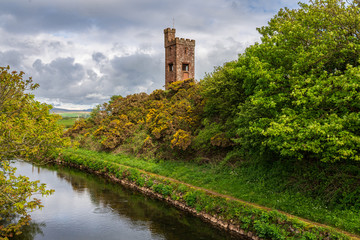 The Braystones Tower and the River Ehen in Braystones, Cumbria, England, UK