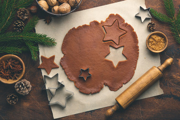 Christmas and New Year bakery. Cooking traditional gingerbread cookies. Wooden backround