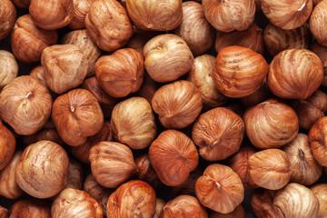 Hazelnut background. Peeled hazelnut kernels