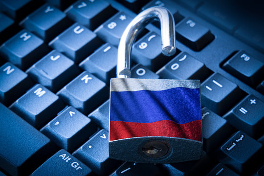 Cyber security concept open padlock on the computer keyboard with russian flag.
