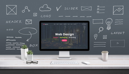 Web design concept with computer display, web theme and drawings of website, app parts. Modern design web page on computer display. Office, studio work desk.