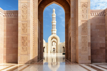 View of minaret through arches of Sultan Qaboos Grand Mosque