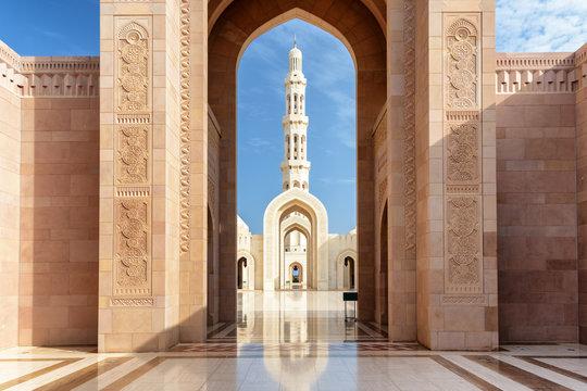 View of minaret through arches of Sultan Qaboos Grand Mosque