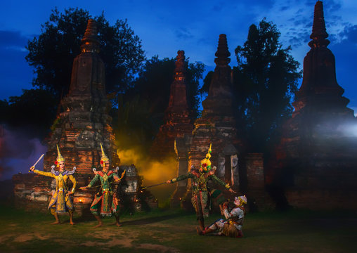 Khon exquisite masked dance drama at night with old pagoda background.Khon is the culture of Thailand.