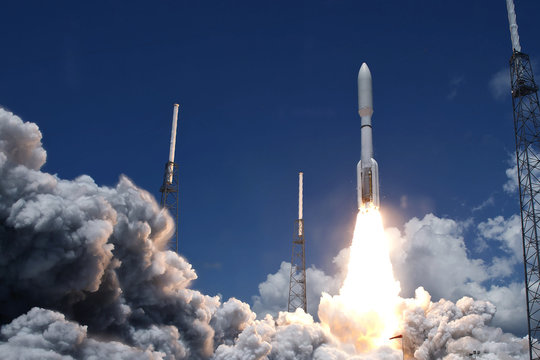 The launch of a space rocket. With smoke and fire. Elements of this image were furnished by NASA.