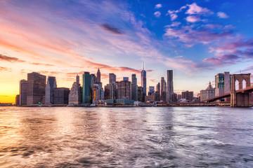 New York City Lower Manhattan with Brooklyn Bridge at Sunset