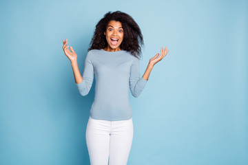 Photo of curly wavy cheerful nice pretty brown haired girlfriend shouting in white trousers hearing unbelievably good news isolated over blue pastel color background Wall mural