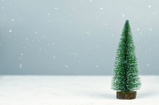 Christmas tree on snowy background with copy space. Christmas background