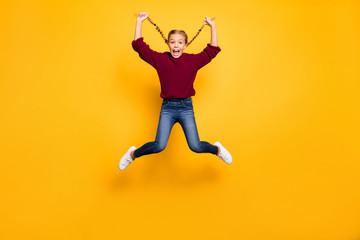 Full length body size view of her she nice attractive crazy girlish cheerful cheery pre-teen girl jumping having fun free time fooling isolated on bright vivid shine vibrant yellow color background Wall mural