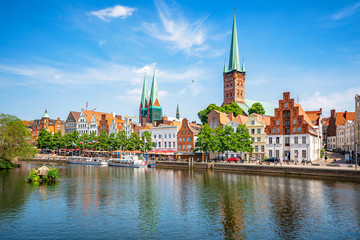 Fotobehang Noordzee Classic panoramic view of historic skyline of hanseatic town of Lübeck with famous St. Mary's Church on a beautiful sunny day with blue sky in summer, Schleswig-Holstein, Germany