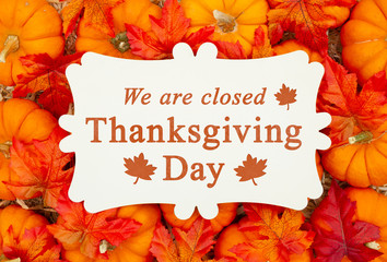 We are Closed Thanksgiving Day sign on a metal sign on pumpkins