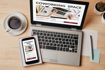 Coworking space concept on laptop and smartphone screen